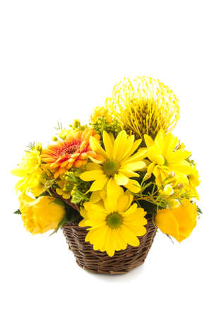 Beautiful yellow bouquet in wooden basket isolated over white photo