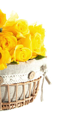 yellow roses: Yellow roses in wooden basket isolated over white