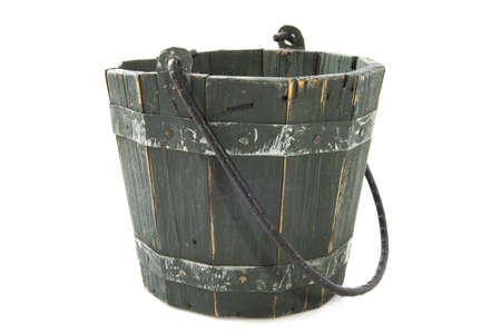Bucket made of wood isolated over white photo