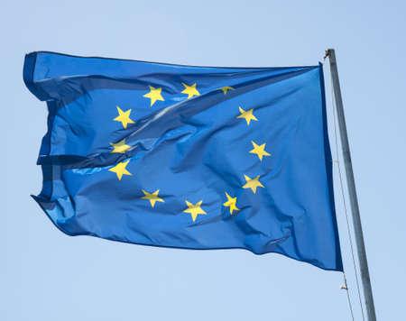 unification: Waving european flag on a blue sky Stock Photo