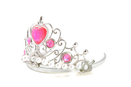 Silver crown with pink gems isolated over white photo