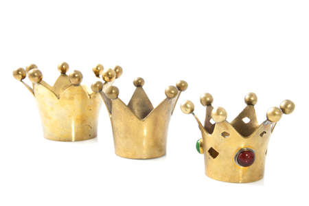 cupper: Three golden crowns in a row isolated over white