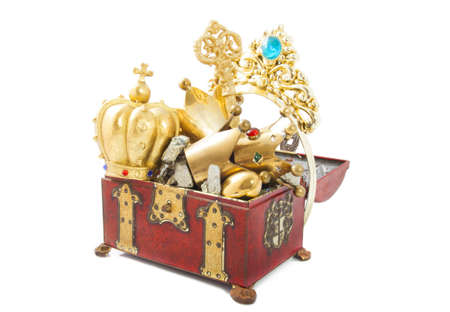 Treasure chest filled with gold isolated over white photo