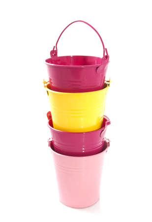 Four colorful buckets on a pile isolated over white photo