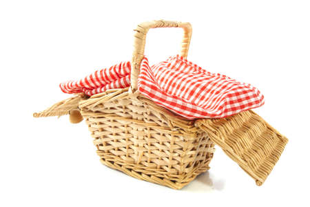 picknick: Wooden basket with cloth isolated over white