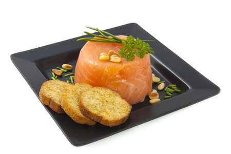 Smoked salmon with toast on a black plate photo