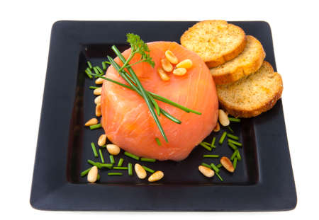 Smoked salmon with toast isolated on a black plate photo