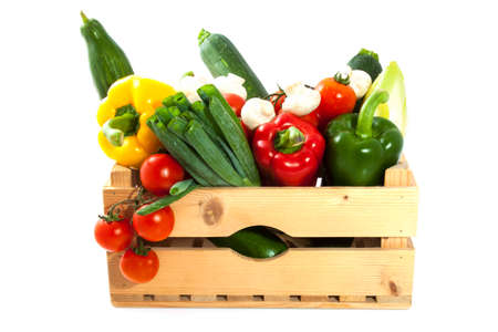 Different kind of vegetable in a wooden crate Stock Photo