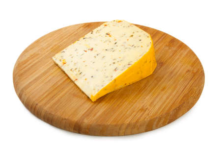 Cheese with herbs on a wooden plate
