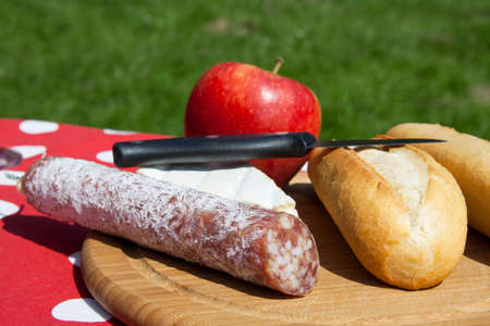 picknick: Bread sausage and cheese on a picnic table Stock Photo