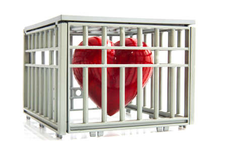 locked in: Red heart locked up in a cage