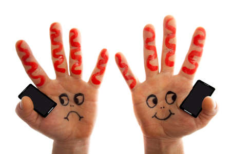 handsfree: Hands holding phones  and having a conversation Stock Photo