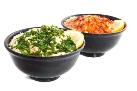 spread: Two bowls with fresh hummus isolated over white Stock Photo