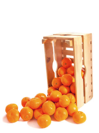 clementines: Wooden crate fresh clementines isolated over white Stock Photo