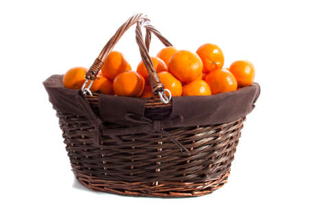 clementines: Basket filled with fresh clementines isolated over white Stock Photo