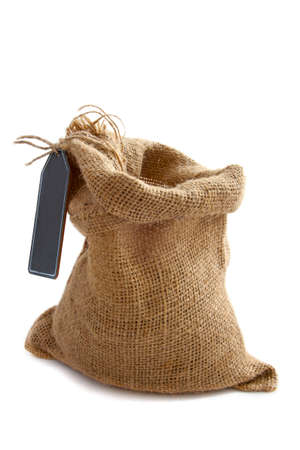 jute: Jute bag filled with beans isolated over white Stock Photo