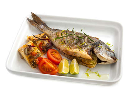 Oven cooked fish dorade with bread an spices