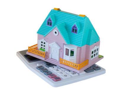 toy house and calculator on an isolated background photo