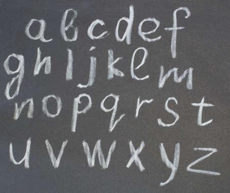 chalk on a blackboard written alphabet for the study photo