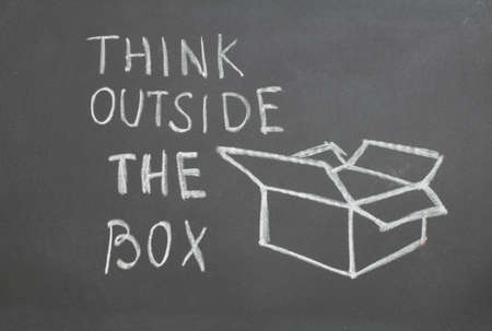 chalkboard with the words to think outside the box Stock Photo