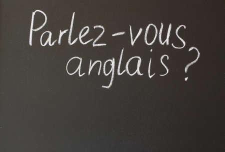 speak english: inscription in chalk on a blackboard - do you speak English
