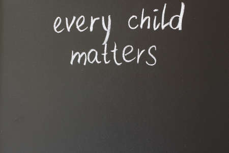 every: inscription in chalk on the blackboard - every child matters