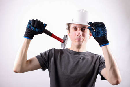 working professional in the helmet with a hammer on a white background