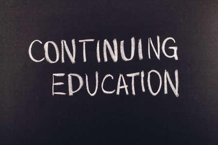 writing with chalk on a blackboard Stock fotó