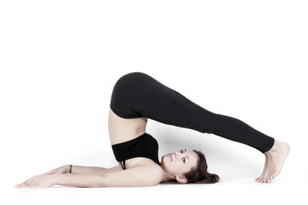 Healthy lifestyle concept. Young and beautiful woman doing fitness and yoga classes on a white background. A series of different exercises.