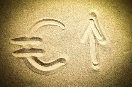 monetary devaluation: symbol of the euro sign in the sand