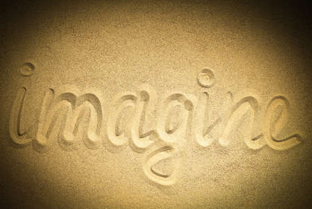 imagine word on sand Stock Photo