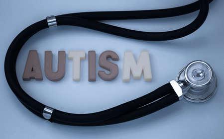 mental illness: word autism and stethoscope Stock Photo