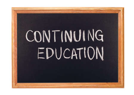 continuing education: Written in white chalk on a blackboard - continuing education Stock Photo