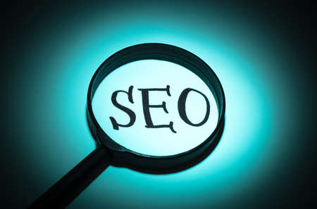 Concept search loupe magnifier SEO button Stock Photo
