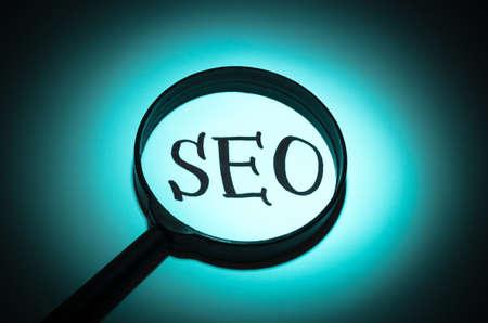 web service: Concept search loupe magnifier SEO button Stock Photo
