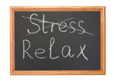 destress: Written in white chalk on a blackboard - stress and relax Stock Photo