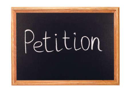 petition: Written in white chalk on a blackboard - petition Stock Photo