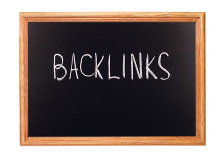 backlink: Written in white chalk on a blackboard - backlink Stock Photo