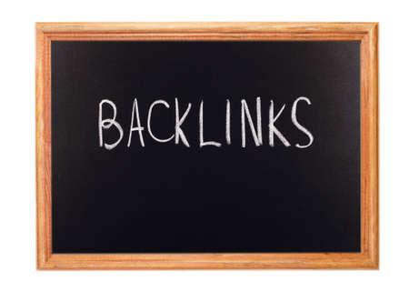 backlink: Written in white chalk on a blackboard - backlink Stock Photo