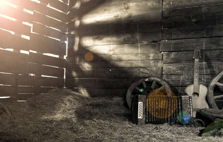 hayloft: stable with a hayloft in the morning dawn Stock Photo