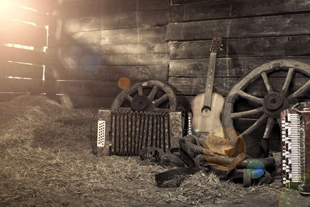 hayloft: Old shed in the morning at sunrise. Musical instruments in the hayloft. Guitar and harmonica