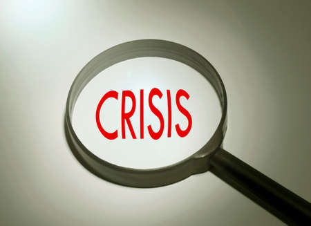 subprime mortgage crisis: Magnifying glass with the word crisis. Searching crisis