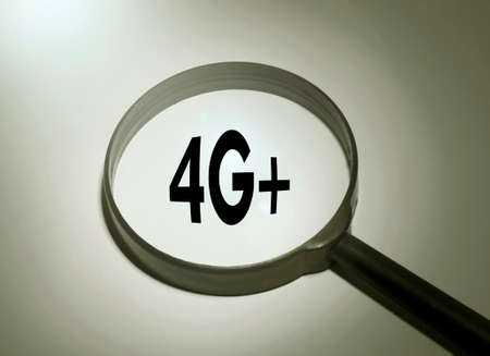 lte: Magnifying glass with the word 4G (lte technology) LTE Stock Photo