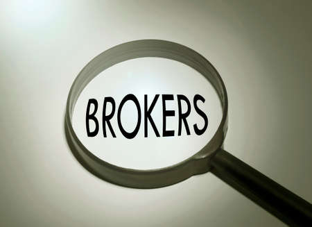 broker's: Magnifying glass with the word brokers