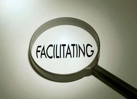 facilitating: Magnifying glass with the word facilitating