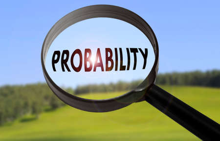 probability: Magnifying glass with the word probability on blurred nature background. Searching probability concept Stock Photo