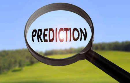 prediction: Magnifying glass with the word prediction on blurred nature background. Searching prediction concept
