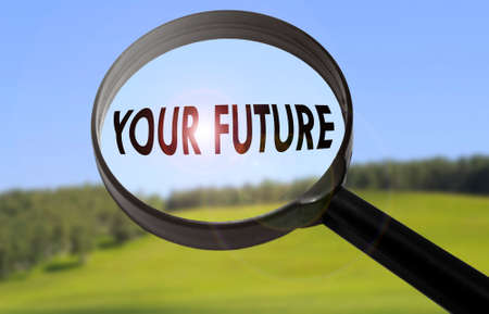 forthcoming: Magnifying glass with the word your future on blurred nature background. Searching your future concept Stock Photo