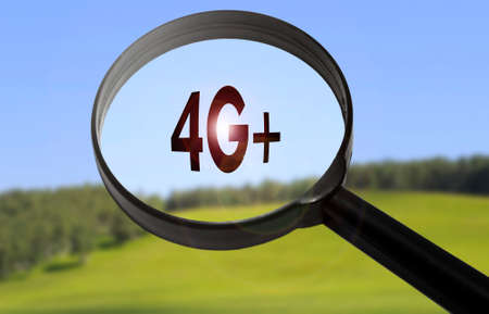 lte: Magnifying glass with the word 4g (lte technology) on blurred nature background. Searching 4g (lte technology) concept