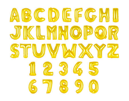 English alphabet and numerals from golden, yellow balloons on a white background. holidays and education Stock Photo